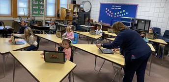 Kindergarten Students Listen to a Read-a-Long in Mrs. Black's SEL class!