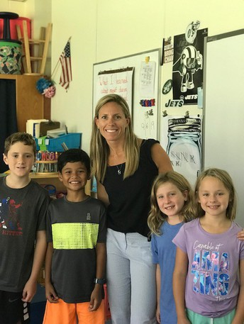 Ms. Crystal Kitselman with 4 students from her class at North Mianus School