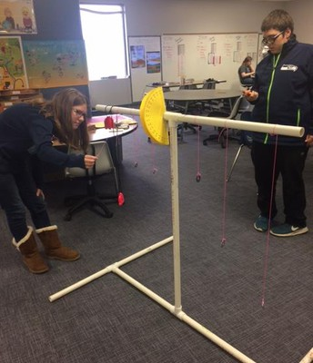 Students learning about pendulums.