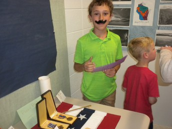 The history of our state, complete with throwbakc moustache