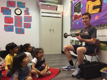 The children enjoyed listening to Brenton play the trumpet.