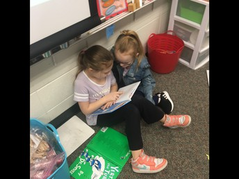 Students reading to someone
