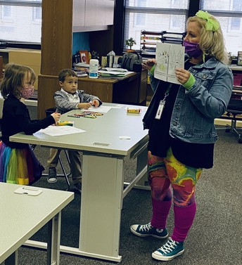 Mrs. Asher in High Ability Was Rocking the 80's Multicolored Vibe!
