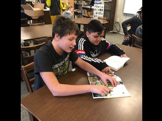These 5th Grade students are sharing their reading with each other in the Media Center!