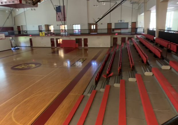Full-size gym with seating to accommodate home games