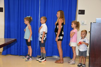 Children of the Board of Trustees Led the Pledge of Allegiance