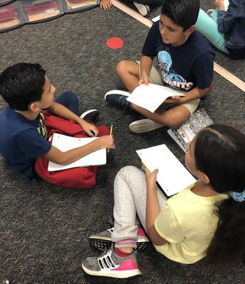 3rd graders storytelling before beginning their seed stories