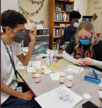 """Pharmacology Students """"dispensing medications"""" and counseling patients. (Mike and Ikes and M&Ms) Fun hands on with a treat at the end!"""