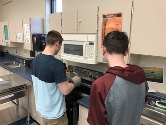 Mrs. Smith's Foods 2 students develop their own popcorn flavoring and prepare it for class