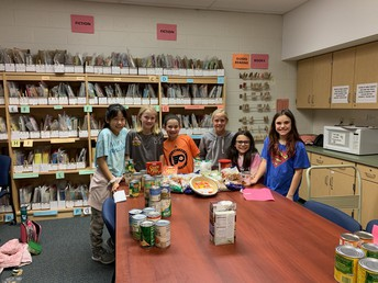 Pine Road Students with Food Pantry Donations
