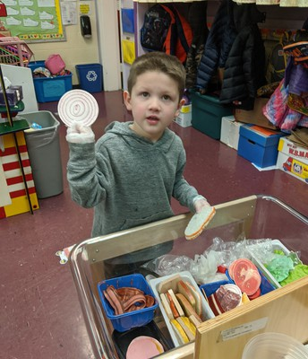 Pre-K students serve up a healthy lunch!  Yum!