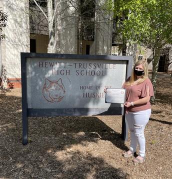 Kirsten Walls in front of Hewitt High School
