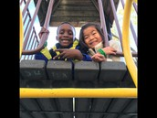 Caelen playing with a friend from 1A on the Jungle Gym
