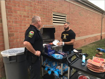Mr. K. and Officer Lawler Grilling at the Social