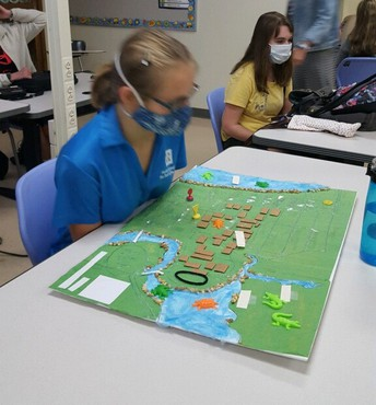 Student looking over her tactile map