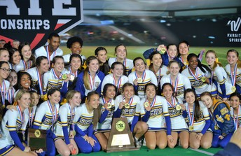 image of cheer squad posing with medals & trophy
