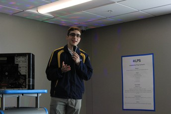 LPS Student Leonardo Quevedo presents information about the project to business and community leaders.
