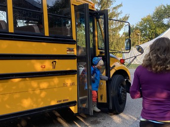 Students getting greeted off the bus.