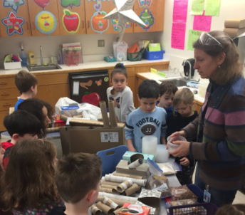 Mrs. Michael helps students choose materials for sound makers