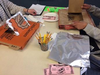 Students making pizza box solar ovens.