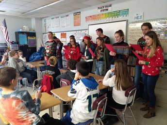 Chardon High School Spanish V students from Carrie Korenke's class visit Chardon Middle School students and sing Christmas carols in Spanish.