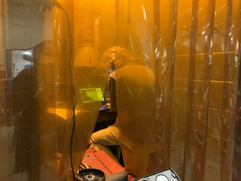 Pictured is welding student, Jackson Niday, participating in a virtual mock interview inside a welding booth.