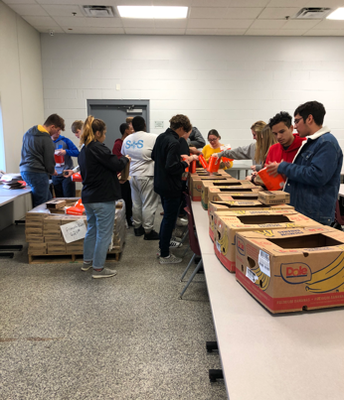 Students box food at the Food Bank