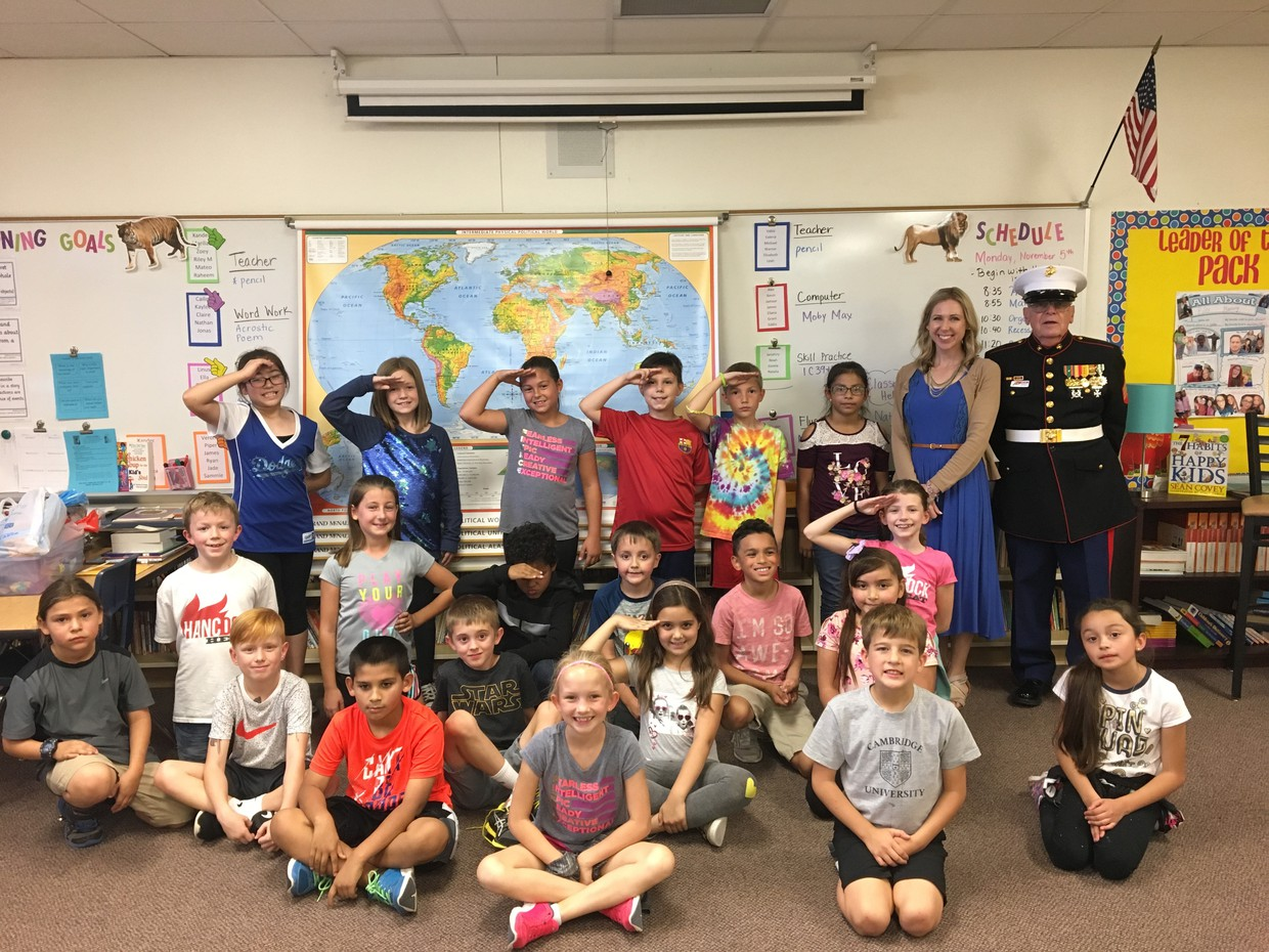 Hancock teacher Meghan Bovard welcomed her father, Sergeant Gregg Girard to speak to her students