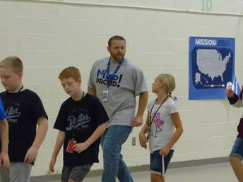 Mr. Rogers dancing with 5th graders