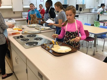 8th Grade Students Cooking in Ms. Boettcher's Class