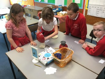 Year Two busy with weighing and measuring