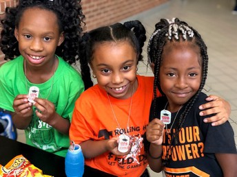 Students could choose from an Attendance bracelet, dog-tag or pencil