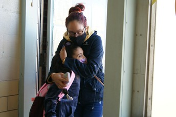 Student hugging mom goodbye at McMahon