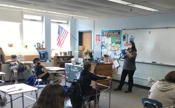 Ms. Driscoll uses 3D shapes to introduce geometry concepts