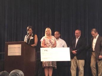 Principal Smith accepting donation on the behalf of Dawson Elementary