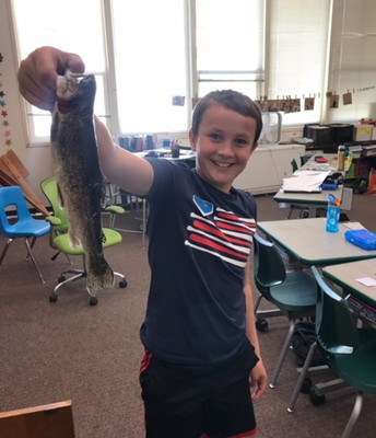 5th grader retrieves fish after flying osprey dropped it on the playground!