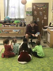 Basketball Teams Read to Elementary Students
