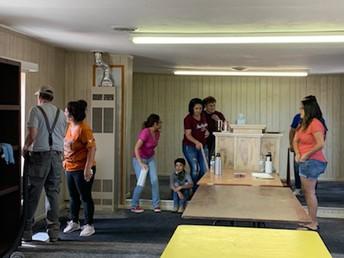Yolanda Tafoya and volunteers expanding the food panty
