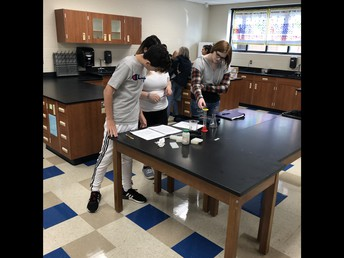 Mr. Hammerand's students work in lab during IES.