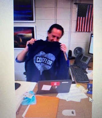 Mr. Tojek showing off his Somers' swag during his Zoom Counseling meeting!