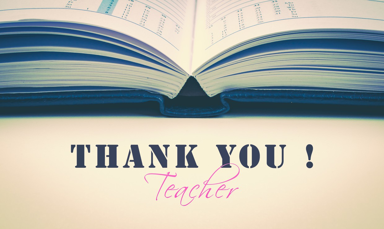 "Book open with ""Thank You! Teacher"" below"