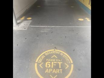 6 foot social distancing reminder at intersections