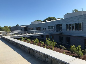 New Lebanon School's building exterior, including the entrance walkway into school