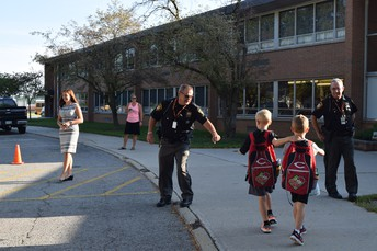 Officer Randy welcoming students at the Elementary