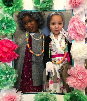 Samori and Ayanna pose in the photo booth in K2A!