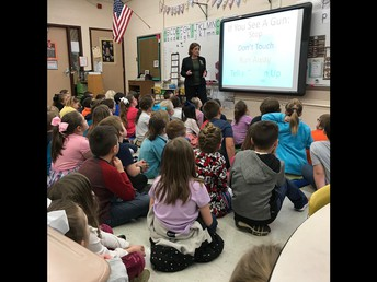 Second Grade enjoys a safety lesson with Officer Katie.