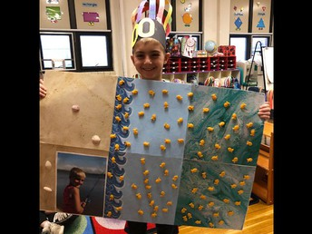 """Kindergarten student Liam McCartney created an ocean masterpiece filled with 100 Goldfish cheddar crackers plus a photo of himself fishing to demonstrate his """"counting to 100"""" proficiency, as well as his creativity."""