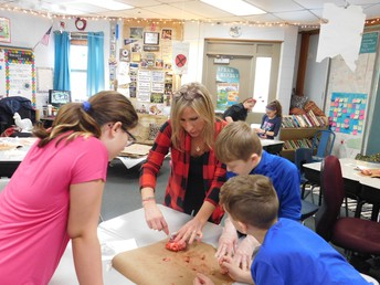 5th grade teacher, Mrs. Hewitt, opening up a sheep's heart.