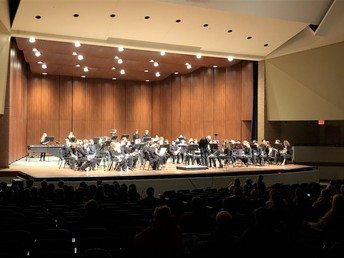 Mr. Doggett and the Wind Ensemble take a bow following their performance