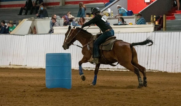 Maddie Johnson riding barrels during the contest show